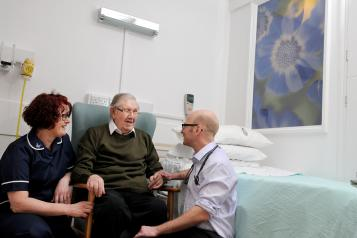 Patient in hospital with staff