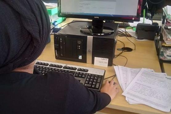 A volunteer inputting data on to the database