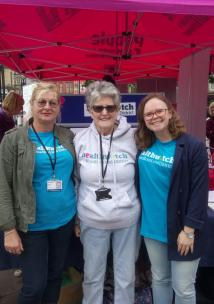 Healthwatch staff and volunteers in front of the Healthwatch stall in City Park, Bradford